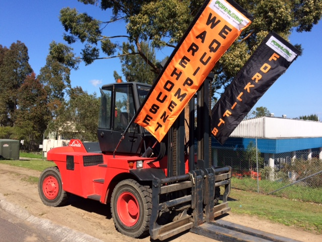 forklifts with banner of warehouse equipment sale and hire